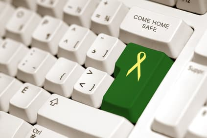 yellow ribbon on green button to sybolized troop support